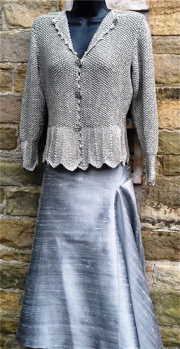 Hand knitted corded silk longer line, fitted, waisted jacket